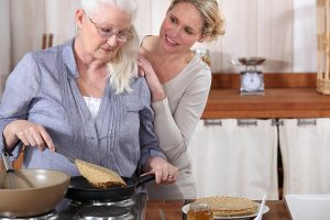 bigstock-daughter-helping-her-senior-mo-25835828